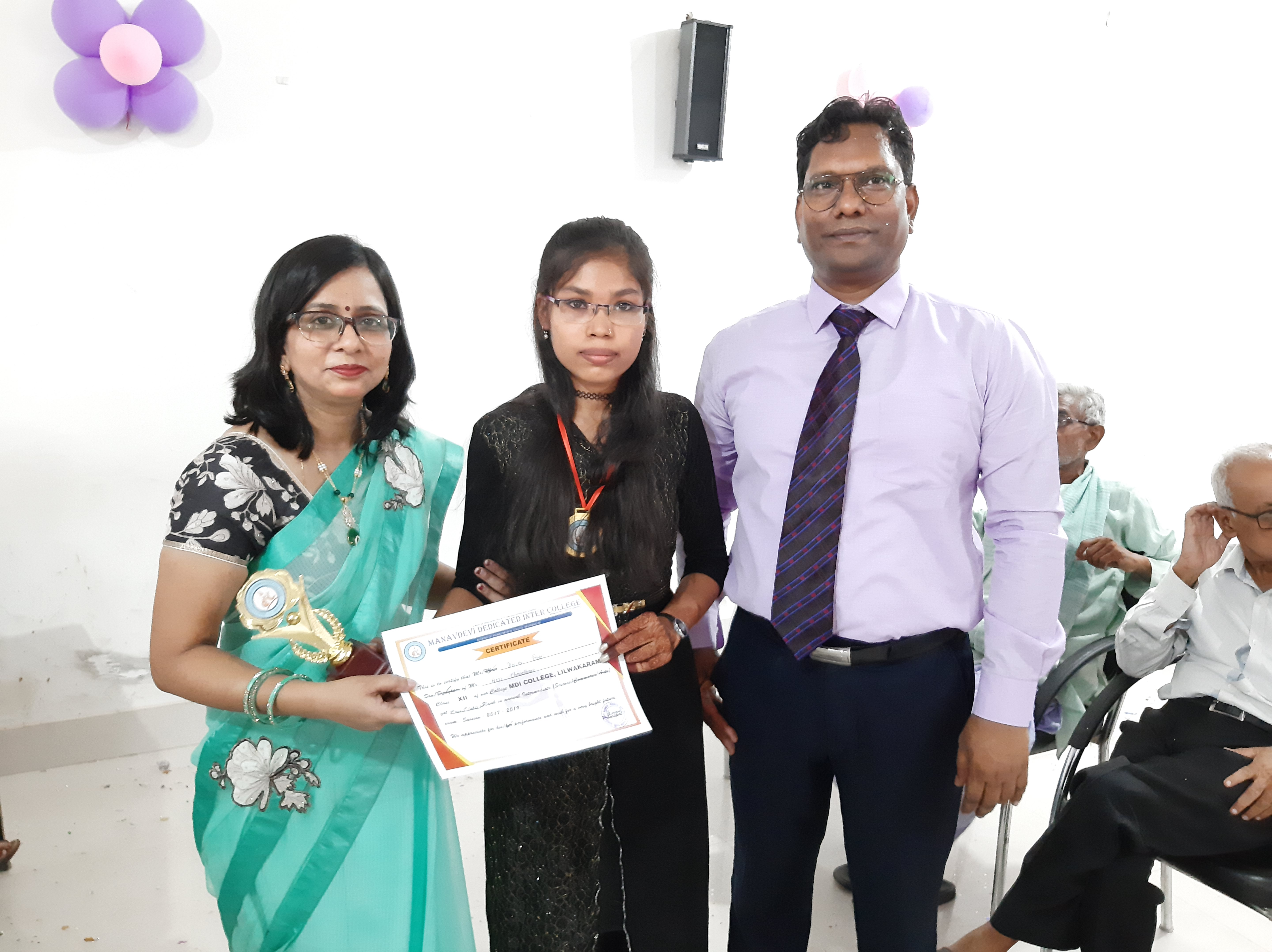 College Topper (Girls) with Er. Binay Sir and Sweta Mam